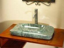 Достоинства каменных раковин для ванной