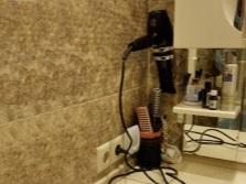 Разновидности держателей для фена в ванную