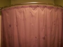 Тканевая угловая штора для ванны