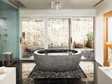 Необычный дизайн каменной овальной ванной