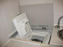 встроенная стиральная машина с вертикальной загрузкой