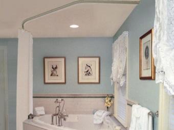 Достоинства угловой штанги для шторки в ванную
