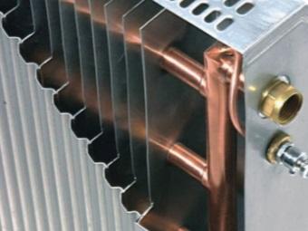 Радиаторы водяного отопления из алюминия и меди для ванной