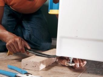 Регулировка ножек стиральной машины для исправной работы