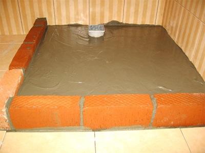 Кирпич и бетон для строительства душевого поддона