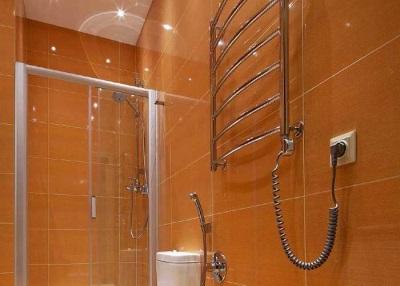 Электрическая настенная сушилка для белья в ванной