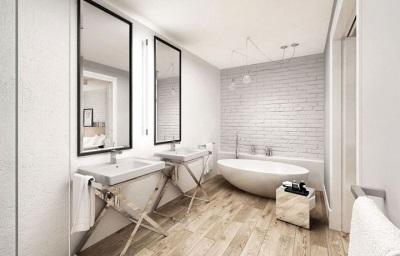 Зеркала в деревянной раме, деревянные стойки под раковину и полы из дерева - характерные черты скандинавской ванной