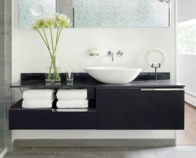 Подвесная тумба необычного дизайна со столешницей из искуственного камня с накладной раковиной для ванной комнаты