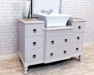 Тумба напольная белого цвета с большим количеством ящичков и  с накладным умывальником в ванной