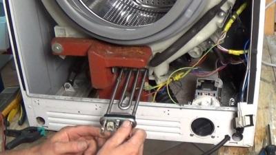 ТЭН расположенный за передней панелью стиральной машины