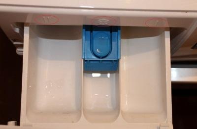 Условные обозначения на контейнере для порошка и кондиционера в стиральной машине-автомат
